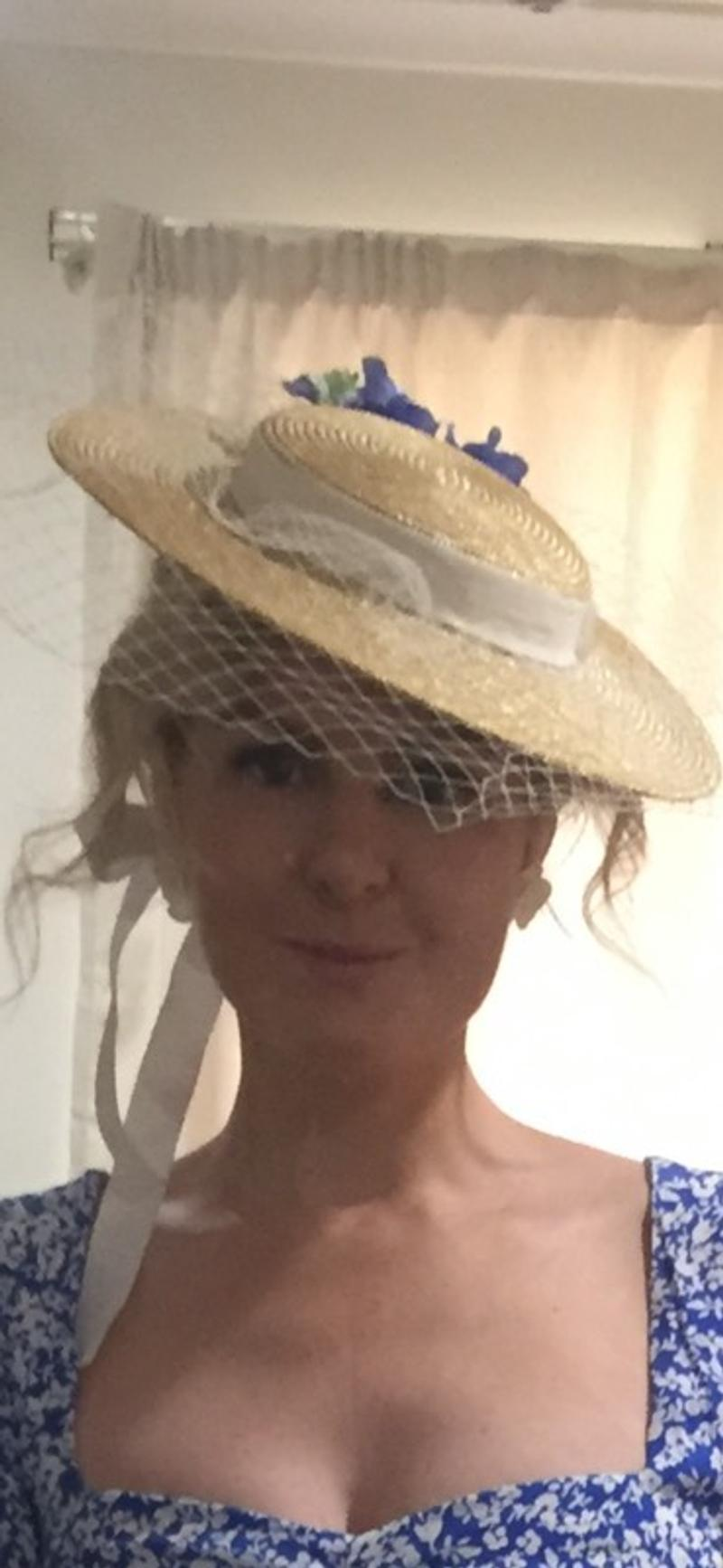 Straw boater with white netting and ribbon