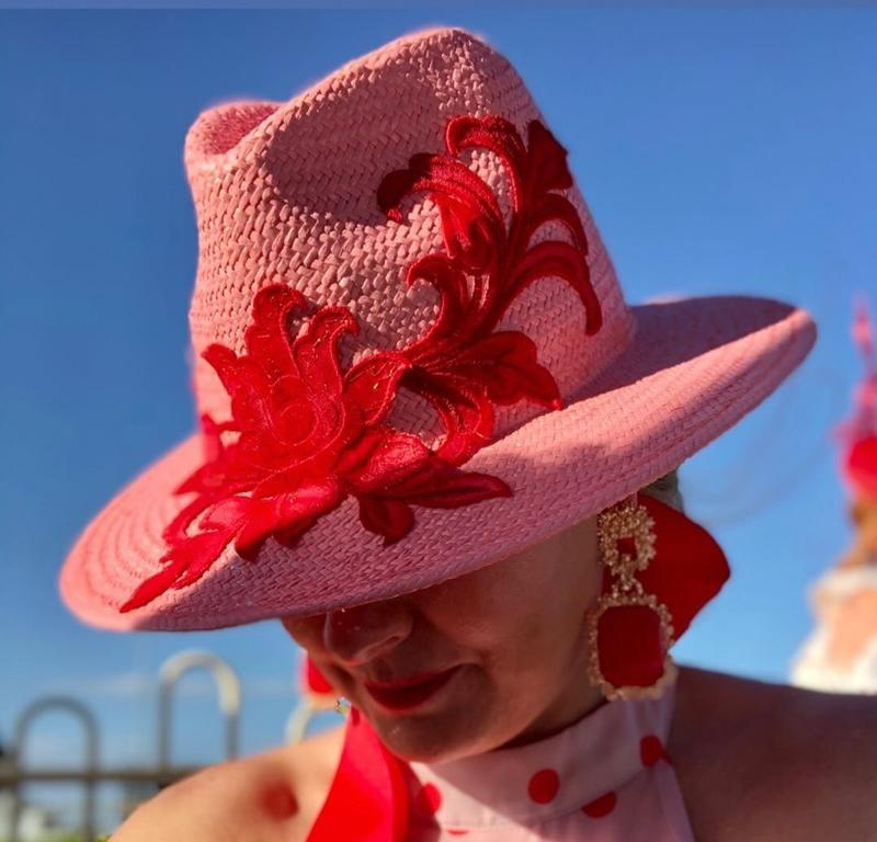 Pink straw fedora with red lace