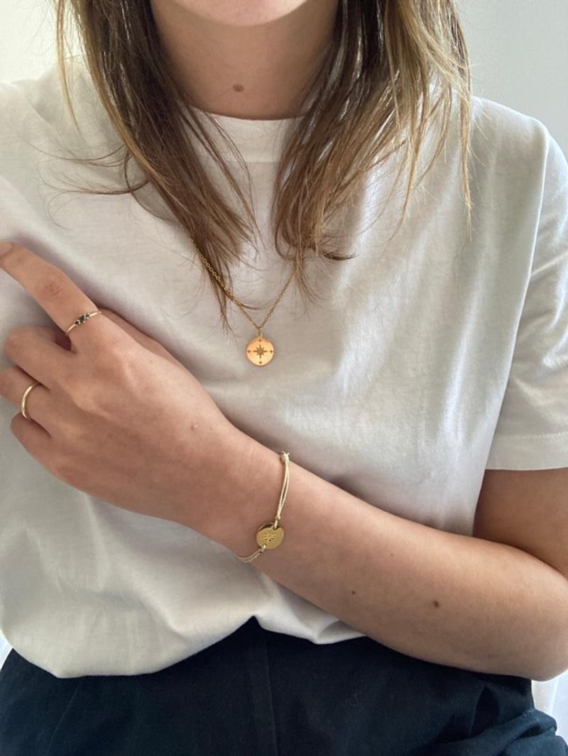 Gold compas necklace star